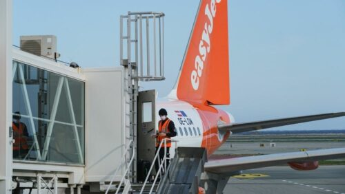 A member of ground crew prepares a passenger aircraft, operated by Easyjet on the tarmac at Nice Cote d
